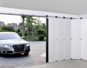 silver audi car pulling into an automated garage door