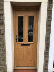 stained wood composite door